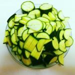 Cut off stem ends of the zucchini. Cut the zucchini into chunks.