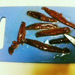 Cut the anchovies into chunks.